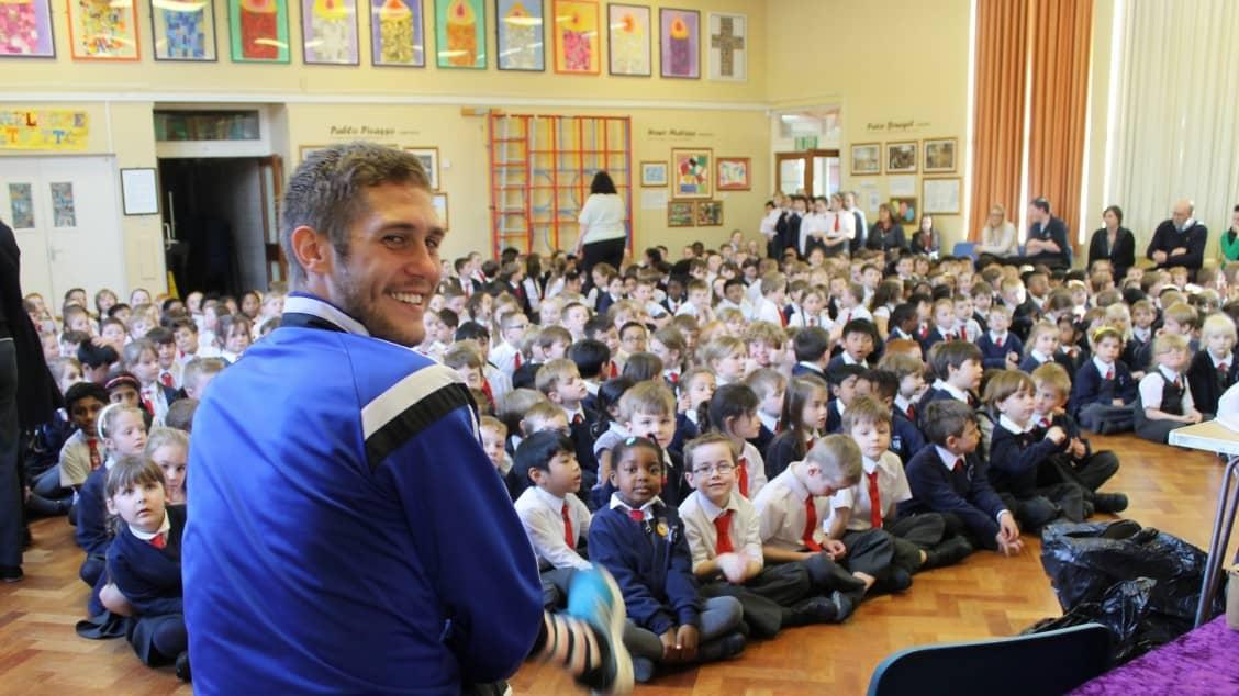 Aldershot Town's Jack Saville with St Joseph's pupils